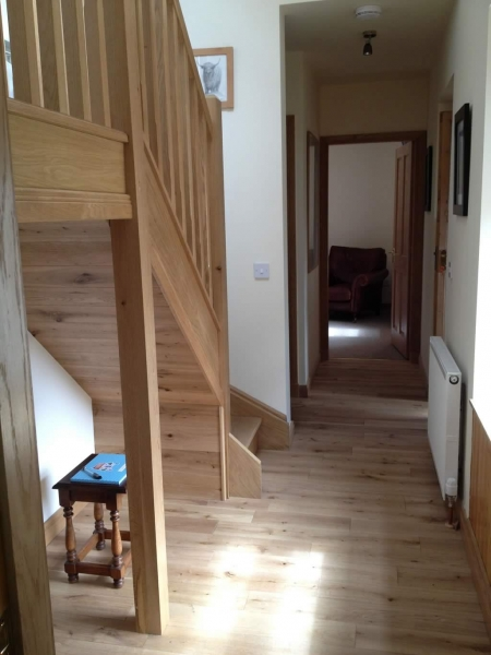 Hallway with stairs up to the twin bedroom